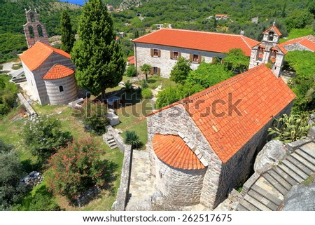 Sunny buildings of an orthodox monastery from the Adriatic sea area, Montenegro - stock photo
