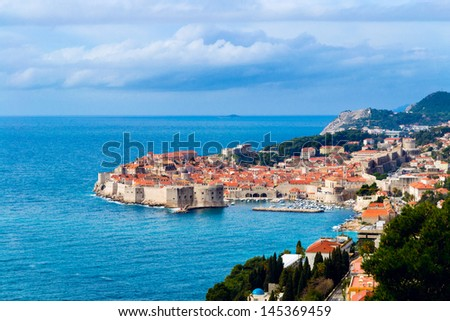Sunny day and spring clouds over the beautiful Dubrovnik old town. - stock photo