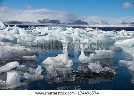 Sunny day at beautiful Glacier Lagoon full with big floating icebergs, Iceland