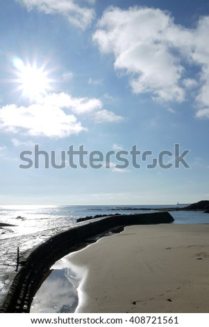 Sunny day at Cullercoats harbour on the Northumberland coastline, England - stock photo
