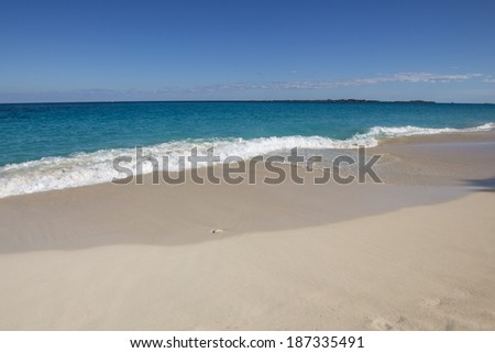 Sunny day at the beach with blue water, in Paradise Island, Bahamas. - stock photo