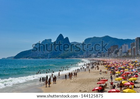 Sunny Day in Crowded Ipanema Beach - stock photo