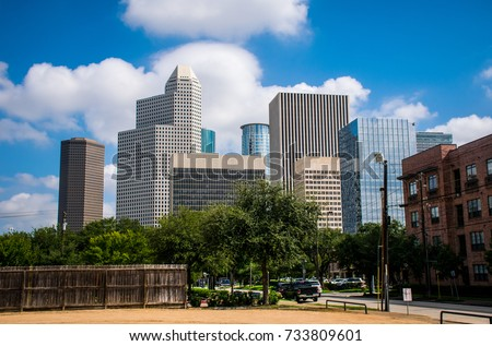 Sunny Day time in Houston Texas Blue Sky Puffy White Clouds and a Huge Cityscape Skyline View October 2017 metropolis of a growing city H-Town