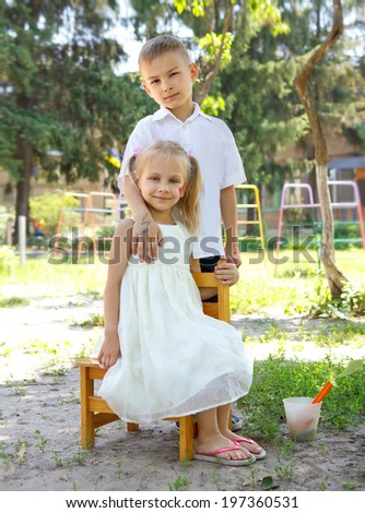 Sunny day.Two child  posing on camera. - stock photo