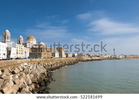 Sunny day with a deep blue sky in Cadiz, Seafront and the Cathedral Campo del Sur. Andalusia region, South of Spain.