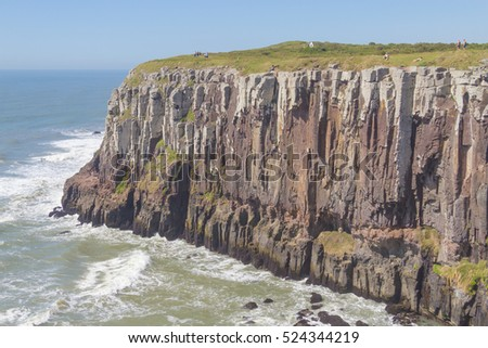 Sunny day with waves and blue sky at Torres Cliffs, Rio Grande do Sul.