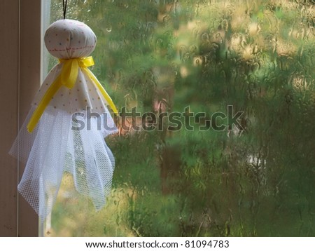 Sunny doll. Japanese hang it to pray for  good weather. - stock photo