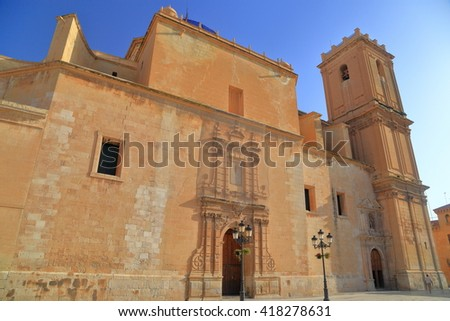 Sunny facade of Santa Maria Basilica in Elche, Alicante, Spain - stock photo