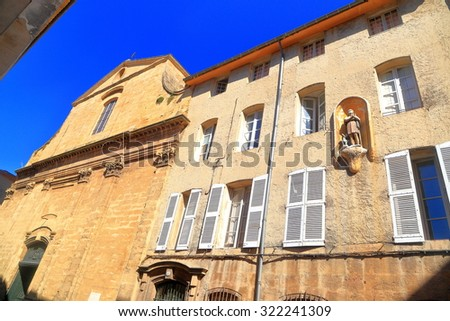 Sunny facades of an old building in Aix-en-Provence, France - stock photo