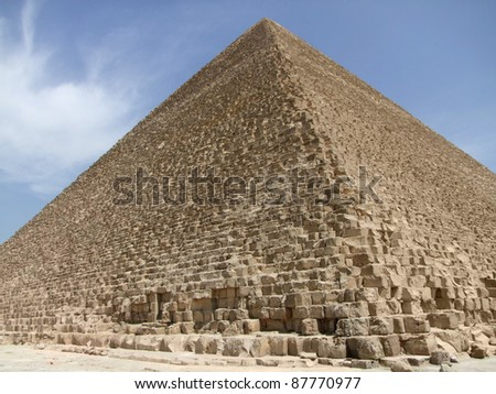 sunny illuminated scenery around Giza Necropolis in Egypt including a angle detail with the Pyramid of Cheops - stock photo