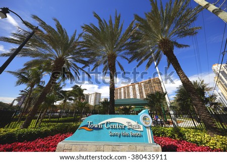 SUNNY ISLES BEACH - FEBRUARY 12: Image of the Town Center Park located at 17200 Collins Avenue offers a pedestrian walking path and children's playground February 12, 2016 in Sunny Isles Beach FL - stock photo