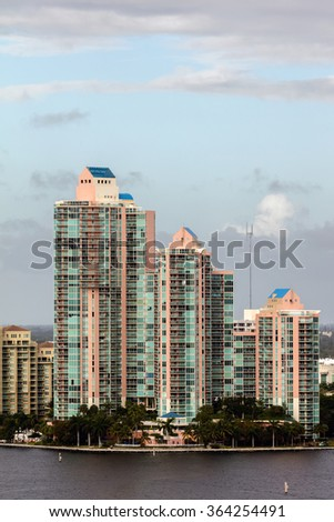 SUNNY ISLES BEACH, FL - DECEMBER 26 2015: Luxury condo buildings in the Sunny Isles Beach, located on a barrier island in northeast Miami-Dade County, Florida.