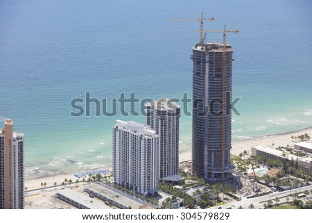 SUNNY ISLES BEACH - JULY 12: Aerial photo of the Porsche Design Tower Sunny Isles Beach FL which will be the tallest building in Sunny Isles at 641 feet once complete July 12, 2015 in Sunny Isles.  - stock photo