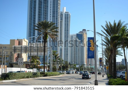 SUNNY ISLES BEACH, USA - NOV 25, 2017: View to Collins avenue and some condominiums and hotels located in Sunny Isles, Florida