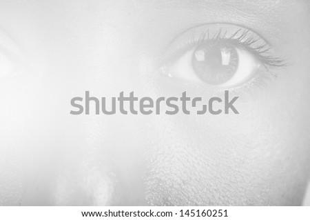 sunny macro photo of a mulatto female eye - stock photo