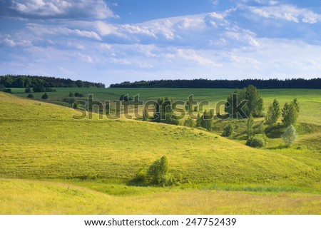 Sunny meadow. Hills in the sunlight. - stock photo