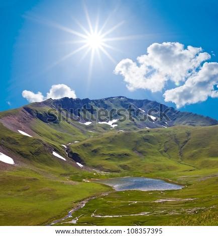 sunny mountain valley - stock photo