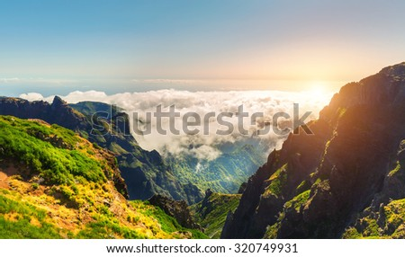 Sunny mountains in clouds