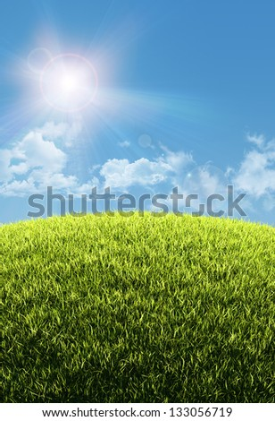 Sunny natural summer background with grassy hill and clear blue sky - great copy-space for posters, cards or banners - stock photo