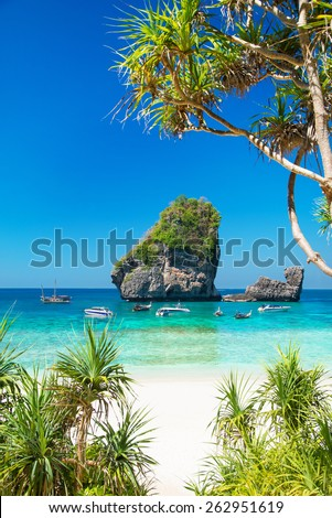 Sunny Nui Bay Beach with longtail boats, Camel rock view, Thailand, Ko Phi Phi Don, Krabi province, Andaman sea - stock photo