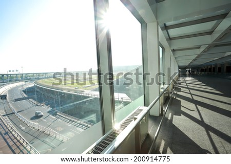 Sunny on modern glass office windows building interior corridor