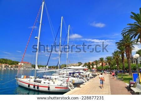 Sunny pier of Venetian town with sail boats at anchor, Makarska, Croatia - stock photo