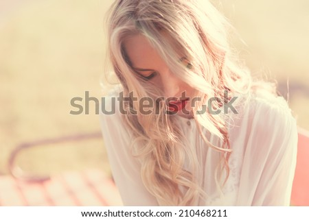 sunny portrait of a beautiful blonde - stock photo