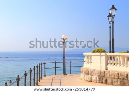 Sunny promenade above the Adriatic sea, Opatija, Croatia - stock photo
