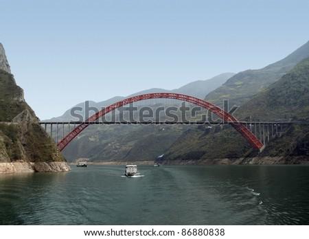 sunny scenery along the Yangtze River in China including bridge and ships - stock photo