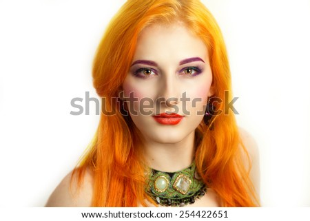 Sunny shiny girl portrait, long bright yellow orange hair, positive person style, art make up, orange lips, purple eyebrows, green neck lace jewelry, white background. Beautiful woman, nude shoulders. - stock photo