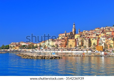 Sunny shore of the Mediterranean sea near the old town of Menton, French Riviera, France