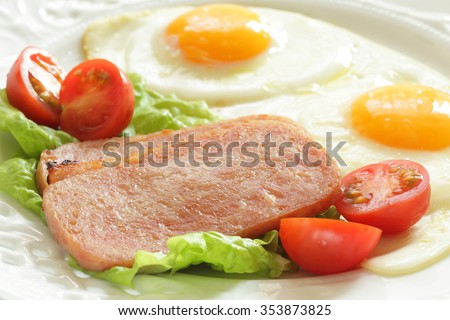 sunny side up fried egg and luncheon meat - stock photo