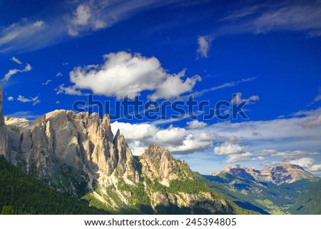 Sunny sky above distant summits of the Catinaccio massif, Dolomite Alps, Italy - stock photo
