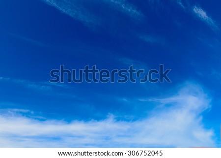 Sunny sky with nice light clouds - stock photo