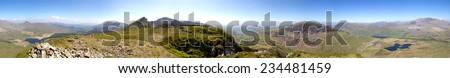 Sunny Snowdonia panorama including Nantile ridge - stock photo