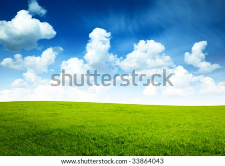 sunny spring day and green field - stock photo