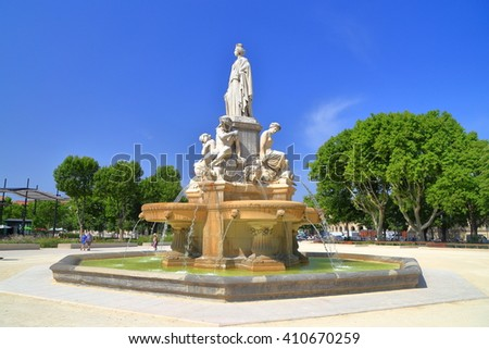Sunny square around the Pradier Fountain in Nimes, Languedoc Roussillon, France