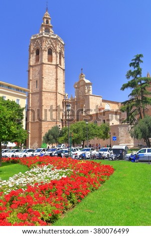 Sunny square in front of Miguelete tower and Metropolitan Cathedral - Basilica of the Assumption of Our Lady of Valencia (known as Saint Mary's Cathedral or Valencia Cathedral), Valencia, Spain - stock photo