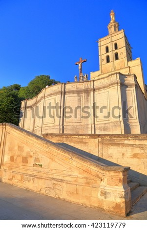 Sunny stone stairs under tall belfry of the Cathedral in Avignon, Provence, France - stock photo