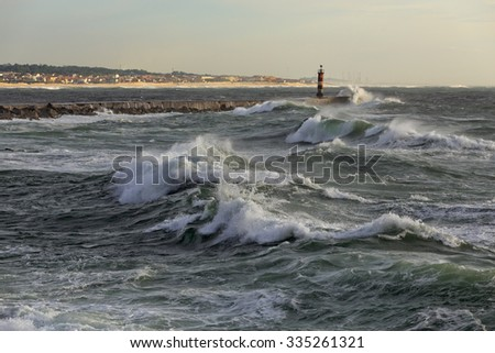 Sunny stormy seascape. Ave river mouth, north of Portugal. - stock photo