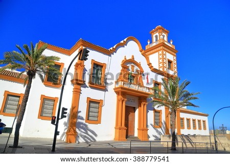 Sunny street with traditional building in Cadiz, Andalusia, Spain - stock photo
