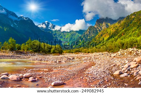 Sunny summer morning in the Caucasus mountains - stock photo