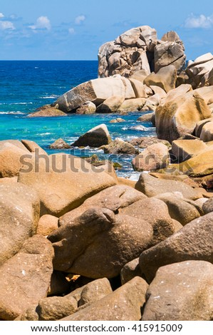 Sunny summer rocky tropical ocean shore perfect place to relax, Seychelles Island - stock photo