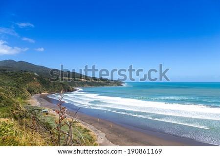 Sunny summer view of Ngarunui surfers beach, near Raglan, Waikato, New Zealand - stock photo
