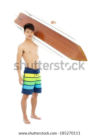 sunny surfer put surfboard on the shoulder - stock photo