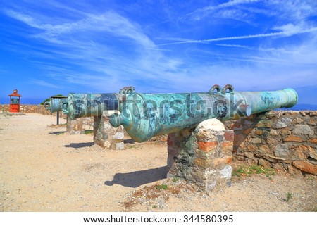Sunny terrace with old canons of the fortress of Saint Tropez, French Riviera, France - stock photo