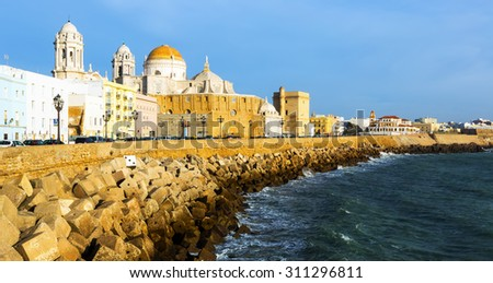 Sunny view of  Cathedral and  embankment. Cadiz, Spain   - stock photo