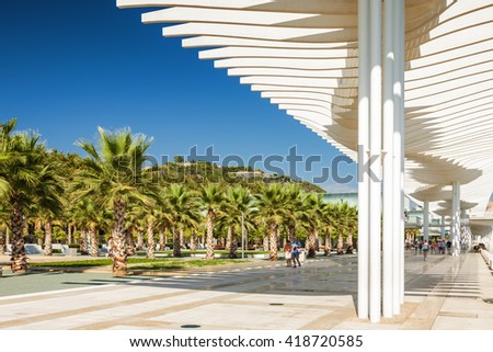 Sunny view of promenade near port of Malaga, Andalusia province, Spain.