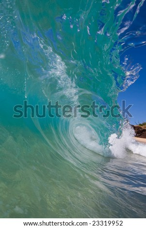 Sunny Wave Breaks on Sand - stock photo