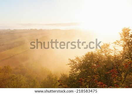 Sunriceand fog in countryside landscape - stock photo